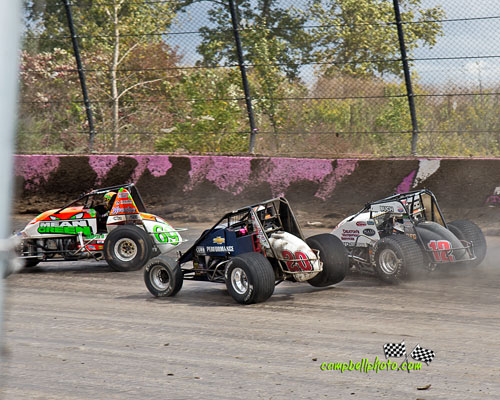 Brady Bacon (#69), Bryan Clauson (#20), and Robert Ballou (#81) racing for the lead during the sprint car portion of the 4-Crown Nationals. - Mike Campbell Photo