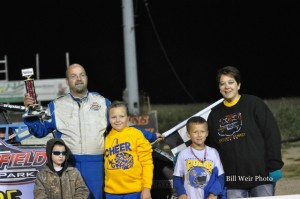Mike Miller with his family in victory lane on Saturday night at Waynesfield Raceway Park. - Bill Weir Photo