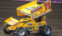 Joey Saldana holds of Donny Schatz to win the opening night of the 4-Crown Nationals with the World of Outlaws STP Sprint Car Series...