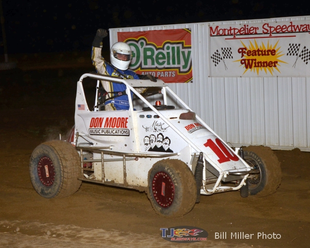 Davey Ray salutes the crowd after winning the midget feature event at the Montpelier Motor Speedway. - Bill Miller Photo