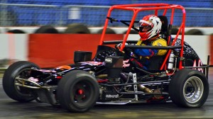 "Russ Gamester, driving a family-owned car built in 1977, became the oldest ""Rumble in Fort Wayne"" midget winner with his victory on opening night last year. He joined Mike Fedorcak as the only drivers to win at both the Memorial Coliseum Expo Center and the old Coliseum track. Photo by Chris Seelman."