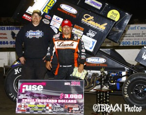 Danny Lasoski won the Bobby Parker Memorial Nebraska 360 Sprint car feature at I-80 Speedway and took home the $3,000 in two dollar bills. - Brad Brown / IBRACN Photo