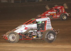 Two-time (2009 & 2011) Oval Nationals Champion Damion Gardner and 2012 winner Mike Spencer battle for position at Perris Auto Speedway.   -Doug Allen Photo
