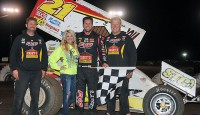 It came down to a matter of inches, as Brian Brown rallied from 14th to nip Aaron Reutzel at the line in Thursday night's 27th Annual COMP Cams Short Track Nationals presented by Hoosier Tires 25-lap preliminary feature at I-30 Speedway.