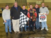 Anthony Nocella and crew celebrate winning the 50 lap Rumble Racing Series event at the Memorial Coliseum Expo Center on Friday night December 26, 2014. - Bill Miller Photo