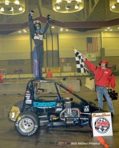 Justin Peck celebrates winning the 50 lap Rumble Racing Series event at the Memorial Coliseum Expo Center on Saturday night December 27, 2014. - Bill Miller Photo