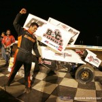 Aaron Reutzel exits his car after winning the finale of the Winter Heat Sprint Car Showdown on Saturday night at Cocopah Speedway. - Serena Dalhamer Photo