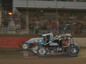 Ryan Bernal (56) edges Dave Darland (16) at the line in Saturday's E&K Winter Challenge Round Two at Canyon Speedway Park. (Terry Shaw Photo)