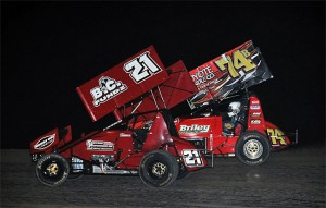 Tyler Thomas (21) and John Carney II (74b) battle for the lead in the closing laps of Friday's 305 Sprint Car Shootout preliminary feature at Southern New Mexico Speedway. (TWC Photo)