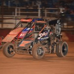 Nathan Smee under another competitor at Valvoline Raceway. (Image courtesy of Sydney Speedway)