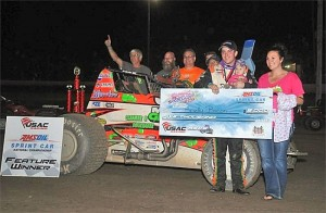 Brady Bacon with his crew and family in victory lane at Tri-State Speedway. (Image courtesy of USAC)