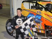 Jimmy McCune in victory lane Friday night at Spartan Speedway. (Bob Buffenbarger Photo)