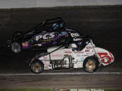 Chris Windom (#5) passes Mickey Kempgens (#66) for the lead Saturday night at the Pay Less Little 500. (Bill Miller Photo)