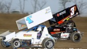 Paul Weaver (#1W) racing with Trey Jacobs (#3J) Friday night at Attica Raceway Park. (Action Photo)