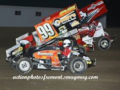 Alvin Roepke (#99), Brian Gibbs (#87) and Rick Daugherty (#14) racing for position Friday night at Attica Raceway Park. (Action Photo)