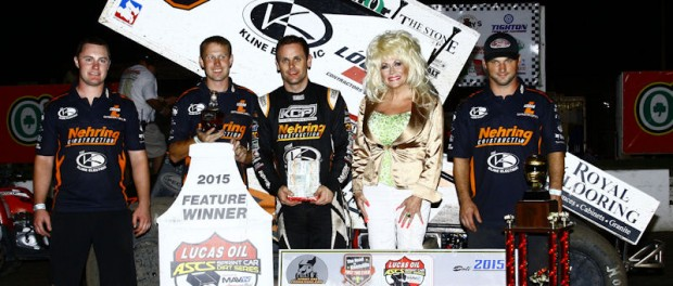 Ian Madsen parked in Victory Lane with the Lucas Oil American Sprint Car Series presented by the MAVTV Motorsports Network for the first time on Thursday night at the I-80 Speedway. (ASCS / Brad Brown)