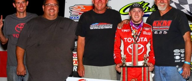 Kevin Thomas, Jr. with the members of Keith Kunz Racing in victory lane Tuesday night after winning the Chad McDaniel Memorial. (Rich Forman Photo)