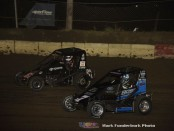 Tanner Thorson (#67) racing with Darren Hagen (#7) for the lead during the POWRi midget car feature Friday night at Jacksonville Speedway. (Mark Funderburk Photo)