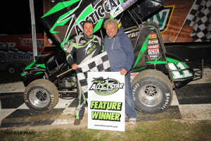 Kraig Kinser standing in Bubba Raceway Park victory lane with his father Steve Kinser on Friday, February 5. (Paul Arch Photo)