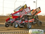 Tyler Gunn (#68), Chris Andrews (#73), and Caleb Griffith (#33) racing at Attica Raceway Park. (Mike Campbell Photo)