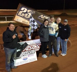 Brian Bell with his crew in victory lane. (Mike Miller Photo)