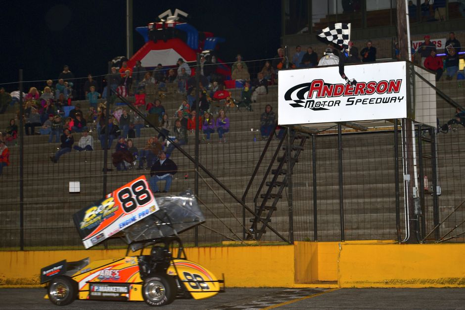 Jimmy McCune celebrates his victory Friday at Anderson Motor Speedway. (Chris Seelman Photo)