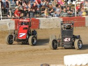 #7 Gage Walker and #43 Logan Arnold battle for position during heat race action. (Bill Miller Photo)