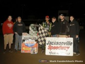 Bryan Clauson with his family and crew in victory lane Friday after winning the POWRi midget car series feature at Jacksonville Speedway. (Mark Funderburk Photo)