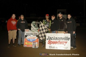 Bryan Clauson with his family and crew following his POWRi midget car feature victory at Jacksonville Speedway. (Mark Funderburk Photo)