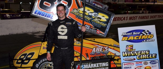 Jimmy McCune holding a broom in victory lane following his second victory of the weekend with the Must See Racing sprint car series. (Chris Seelman Photo)