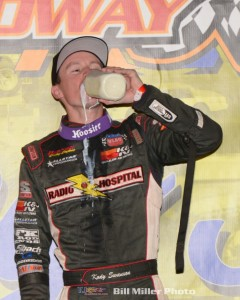 Kody Swanson taking the traditional drink of milk. (Bill Miller Photo)