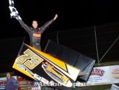Chris Andrews celebrates following his victory Friday night at Attica Raceway Park. (Action Photo)