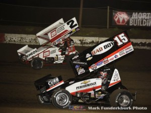 Shane Stewart (#2) racing with Donny Schatz (#15) Wednesday during the World of Outlaws Craftsman Sprint Car Series event at Jacksonville Speedway. (Mark Funderburk Photo)