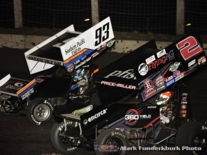 Sheldon Haudenschild (#93) racing with Parker Price-Miller (#2) Friday with the Arctic Cat All Star Circuit of Champions at Lincoln Speedway. (Mark Funderburk Photo)