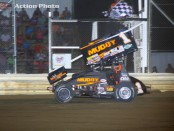 Dale Blaney takes the checkered flag following his victory Friday night with the Arctic Cat All Star Circuit of Champions at Attica Raceway Park. (Action Photo)
