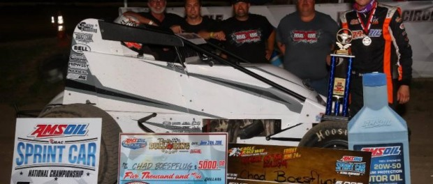 """Chad Boespflug and crew celebrate their USAC AMSOIL National Sprint Car victory Friday night at Eagle (Neb.) Raceway's """"Rumble in the Bullring.""""  (RICH FORMAN PHOTO)"""
