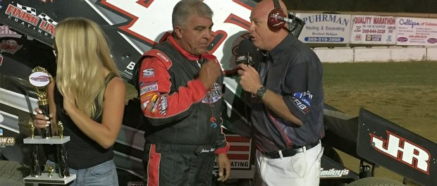 Johnny Herrera being interviewed by Scotty Cook following his feature victory Friday night at the Hartford Motor Speedway. (T.J. Buffenbarger Photo)