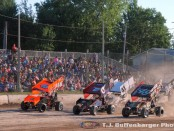 Three wide into turn one during heat race action in front of a full house at Thunderbird Raceway. (T.J. Buffenbarger Photo)
