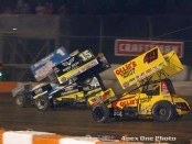 Jacob Allen (#1A), Donny Schatz (#15), and Brad Sweet (#49) racing for the lead on Tuesday at Ohsweken Speedway. (James MacDonald/Apex One Photo)
