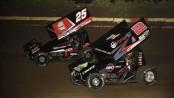 Jake Blackhurst (#25) racing with Parker Price-Miller (#2) Friday night at Jacksonville Speedway. (Mark Funderburk Photo)