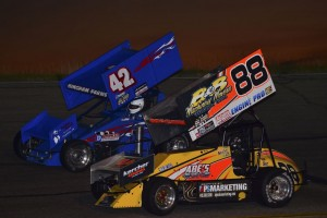 Jimmy McCune (#88) and Jason Blonde (#42) racing for the lead Saturday night at Owosso Speedway. (Chris Seelman Photo)