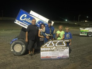"Skylar Gee with his race team in victory lane. (ASCS / ""Good Day Sir Photography"")"