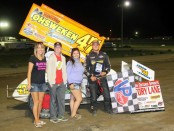 Dylan Westbrook poses in victory lane with representatives from night sponsor Rapid Rad. (Rod Henderson photo).
