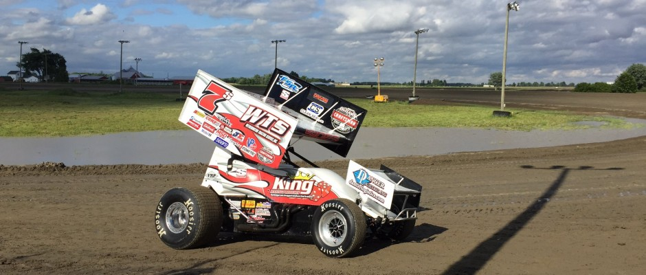 Jason Sides passes by standing water during a second attempt to completed a World of Outlaws Craftsman Sprint Car Program at I-96 Speedway that was disrupted by rain. (T.J. Buffenbarger Photo)