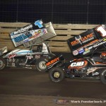 Logan Schuchart (#1S) racing with Sammy Swindell (#1) Saturday night at Knoxville Raceway during the 5-hour ENERGY Knoxville Nationals. (Mark Funderburk Photo)
