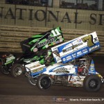 Kraig Kinser (#11K) racing with Terry McCarl (#7K) Saturday night at Knoxville Raceway during the 5-hour ENERGY Knoxville Nationals. (Mark Funderburk Photo)