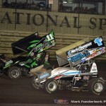 Kraig Kinser (#11K) racing with Logan Schuchart (#1S) Saturday night at Knoxville Raceway during the 5-hour ENERGY Knoxville Nationals. (Mark Funderburk Photo)