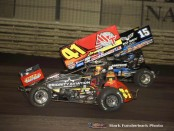 Jason Johnson (#41) inside of Donny Schatz (#15) Saturday night at Knoxville Raceway during the 5-hour ENERGY Knoxville Nationals. (Mark Funderburk Photo)