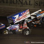 Tasker Phillips (#7W) racing with Dustin Selvage (#7) Friday night at Knoxville Raceway. (Mark Funderburk Photo)