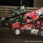 Kraig Kinser (#11K) racing with Davey Heskin (#56) Friday night at Knoxville Raceway. (Mark Funderburk Photo)
